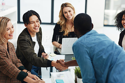 Buy stock photo Shot of a colleagues shaking hands during a brainstorming session at work