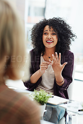 Buy stock photo Shot of two colleagues having a discussion at work in a modern office