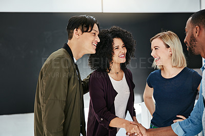 Buy stock photo Shot of businesspeople shaking hands in a modern office