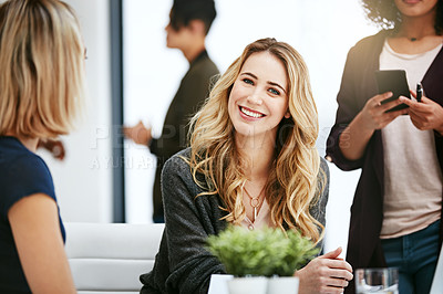 Buy stock photo Portrait of a happy young woman enjoying meeting with her colleagues