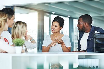 Buy stock photo Shot of a group of colleagues having a discussion at work