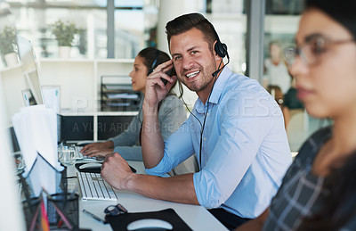 Buy stock photo Portrait of a happy and confident young man working in a call center