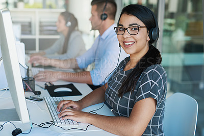 Buy stock photo Portrait of a happy and confident young woman working in a call center