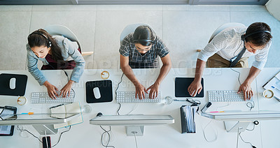 Buy stock photo High angle shot of a team of call center agents working in an office