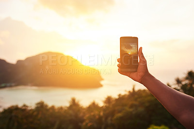 Buy stock photo Cropped shot of an unidentifiable tourist using a smartphone to photograph an island view