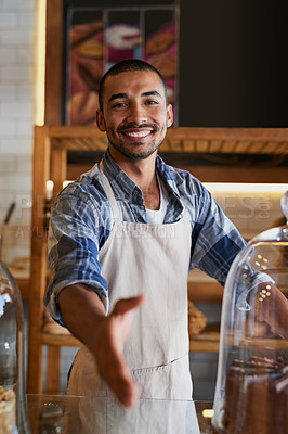 Buy stock photo Portrait of a young business owner extending a handshake