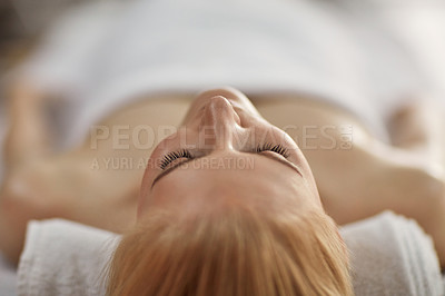 Buy stock photo Closeup shot of a young woman relaxing on a massage table at a spa