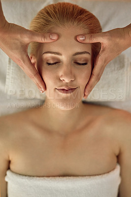 Buy stock photo High angle shot of a young woman enjoying a head massage at a spa