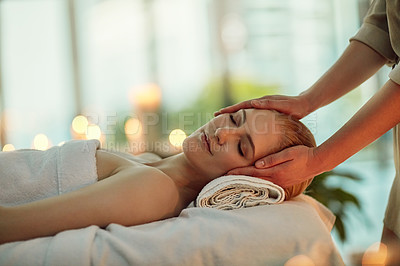 Buy stock photo Cropped shot of a young woman enjoying a head massage at a spa