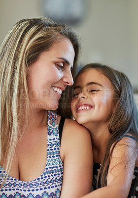 Buy stock photo Cropped shot of a mother and daughter bonding together at home