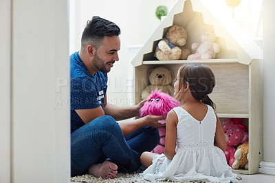 Buy stock photo Shot of a father and daughter playing together at home