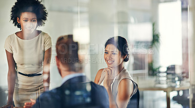 Buy stock photo Cropped shot of a group of colleagues having a discussion in an office