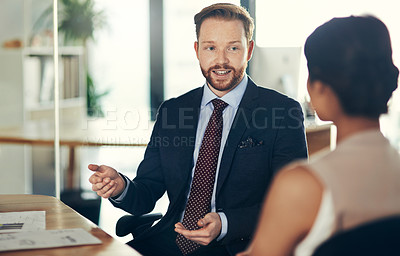 Buy stock photo Cropped shot of colleagues having a discussion in an office