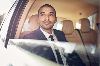Buy stock photo Cropped shot of a businessman sitting in his car