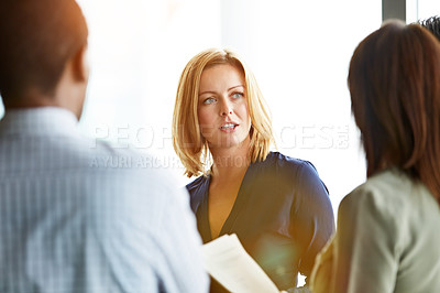 Buy stock photo Shot of a group of coworkers talking together while sitting in an office