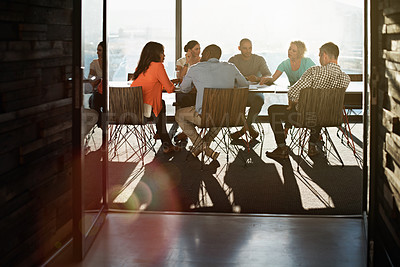 Buy stock photo Shot of a group of colleagues having a meeting together in a boardroom