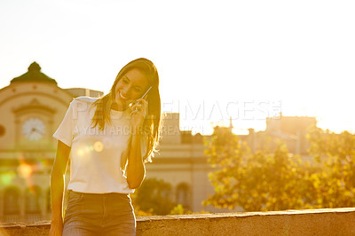Buy stock photo Portrait of an attractive young woman leaning on a wall with the city in the background