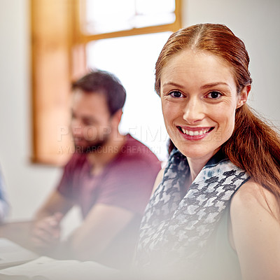 Buy stock photo Portrait of a smiling young businesswoman with a colleague in the background