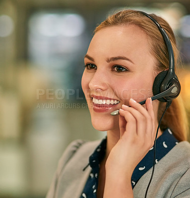 Buy stock photo Shot of an attractive young woman wearing a headset in the office