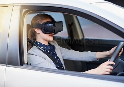 Buy stock photo Cropped shot of a young businesswoman driving while wearing a virtual reality headset