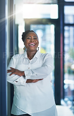 Buy stock photo Portrait of a happy businesswoman posing in the office with her arms folded