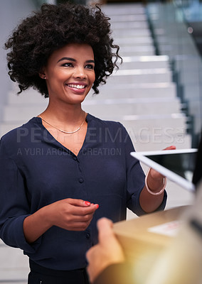Buy stock photo Shot of a happy businesswoman accepting a package from a courier in the office