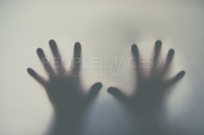 Buy stock photo Defocussed shot of a pair of hands reaching out against a plain background