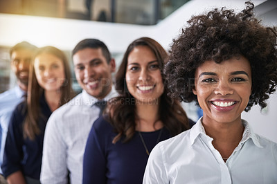 Buy stock photo Portrait of a team of happy businesspeople standing behind each other in the office