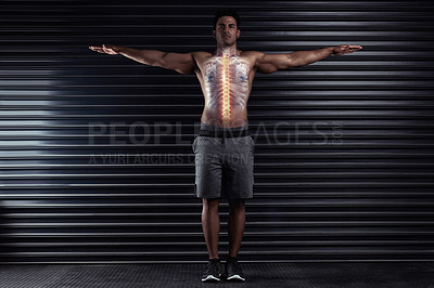Buy stock photo Full length portrait of an athletic young man standing with his arms outstretched