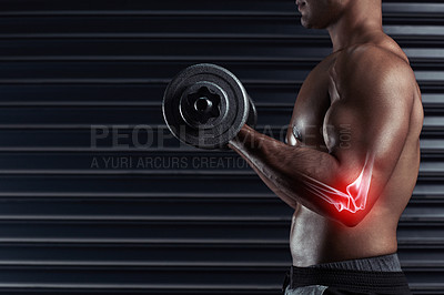Buy stock photo Cropped shot of an unrecognizable young man working out with a dumbbell