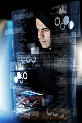Buy stock photo Shot of a young hacker cracking a computer code in the dark