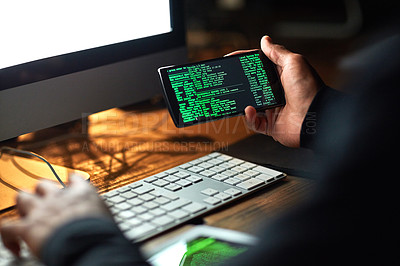 Buy stock photo Cropped shot of an unidentifiable hacker cracking a computer code in the dark