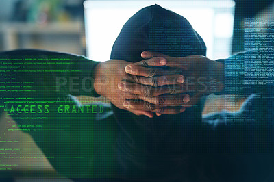 Buy stock photo Rearview shot of an unidentifiable hacker cracking a computer code in the dark