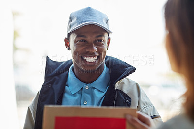 Buy stock photo Cropped shot of a courier making a delivery to a customer