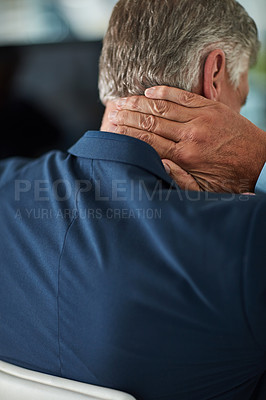 Buy stock photo Rearview shot of a mature businessman rubbing his neck in the office