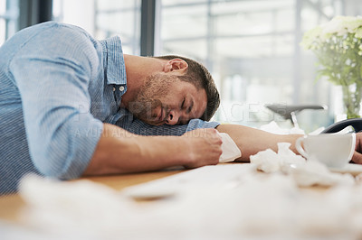 Buy stock photo Cropped shot of a tired young man with his head down on his desk