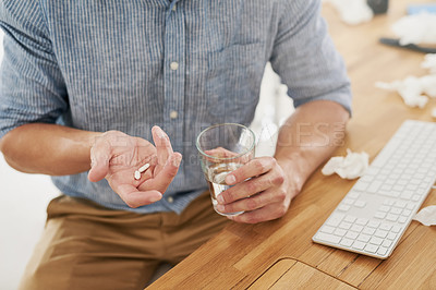 Buy stock photo Closeup shot of an unrecognisable businessman holding a glass of water and medication in an office