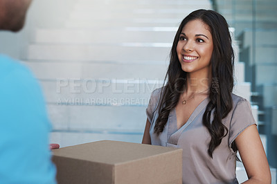 Buy stock photo Cropped shot of a businesswoman accepting a package from a courier in her office