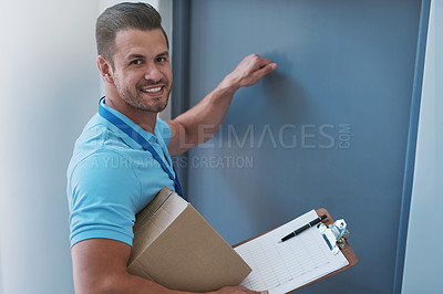 Buy stock photo Portrait of a courier knocking on a door to make a delivery