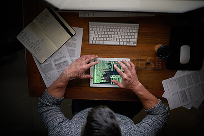 Buy stock photo High angle shot of an unidentifiable computer programmer working alone late at night