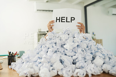 Buy stock photo Shot of an unidentifiable businesswoman drowning under a pile of paperwork in the office