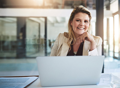 Buy stock photo Portrait of a smiling young businesswoman sitting behind her laptop in the office
