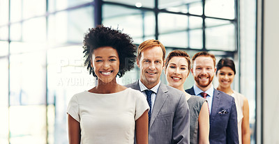 Buy stock photo Portrait of a group of colleagues standing together in an office