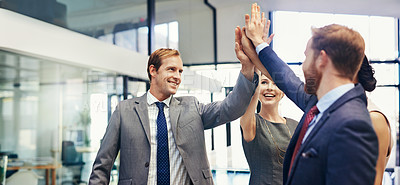 Buy stock photo Shot of a group of businesspeople giving each other a high five