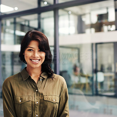Buy stock photo Portrait of a confident and happy young woman working in a modern office