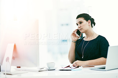 Buy stock photo Shot of a young businesswoman working at her desk in an office