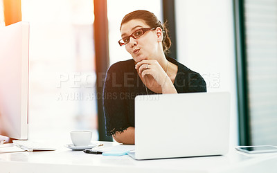 Buy stock photo Portrait of a young businesswoman pouting while working at her desk in an office