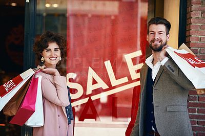 Buy stock photo Shot of a young couple out on a shopping spree