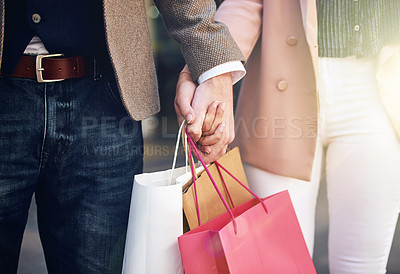 Buy stock photo Cropped shot of an affectionate couple out on a shopping spree