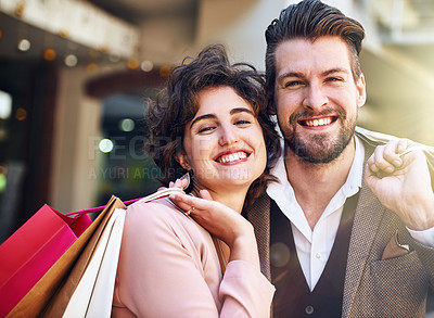 Buy stock photo Shot of a couple out on a shopping spree